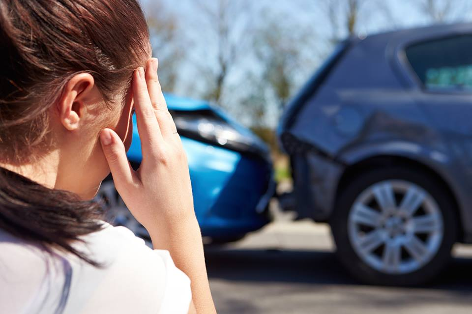 Woman watching rear end car accident