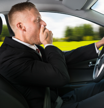Man yawning while driving