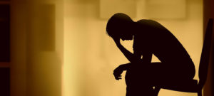 Silhouette of person grieving