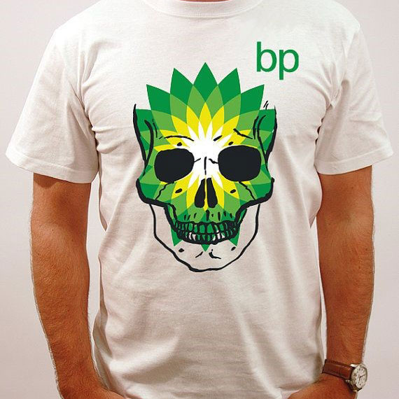 Man wearing t-shirt with green skull logo